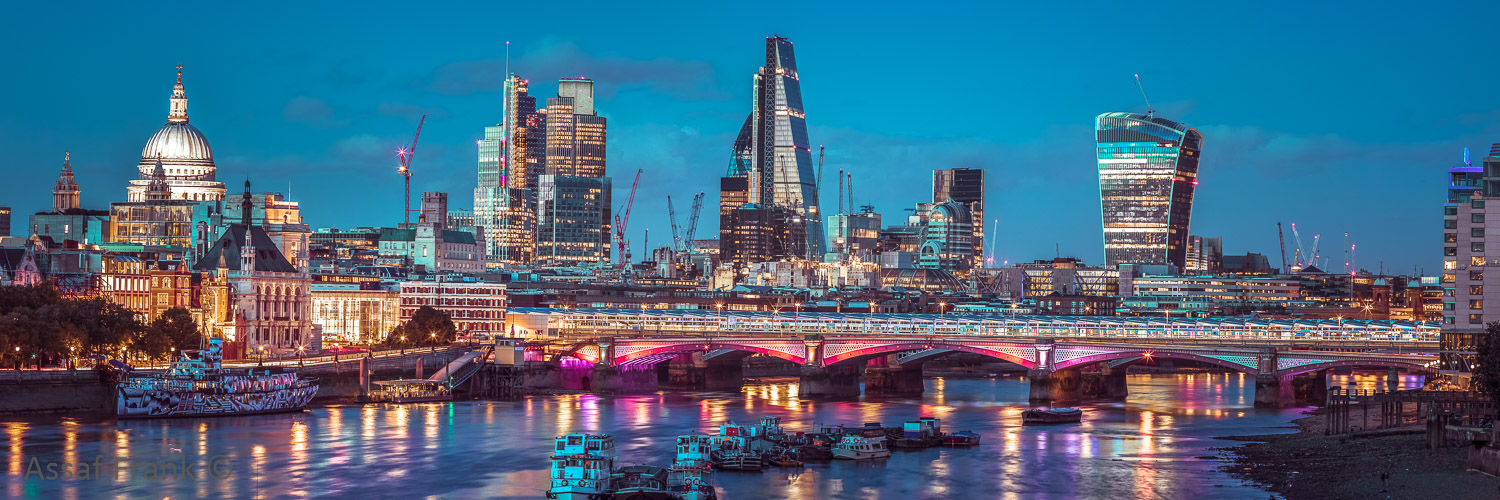 Evening view of Blackfriars Bridge over River Thames with London skyline